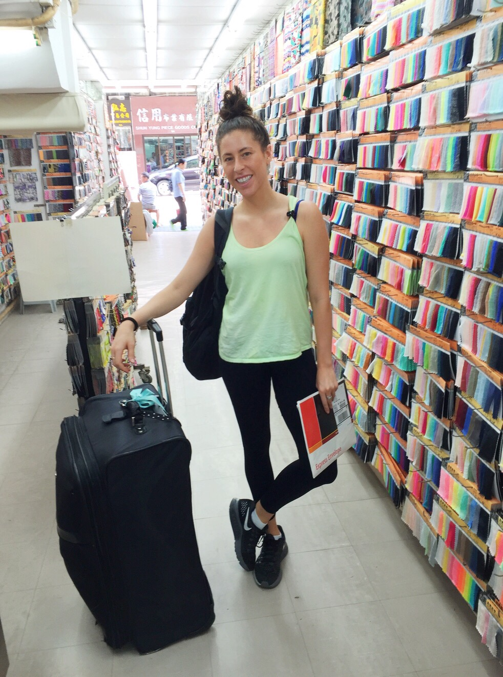 melanie disalvo buying fabric in sham shui po