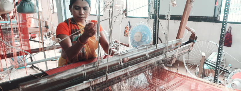 woman on loom weaving khadi