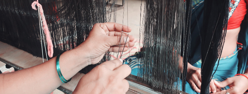 warp yarns passing through heddles on a harness