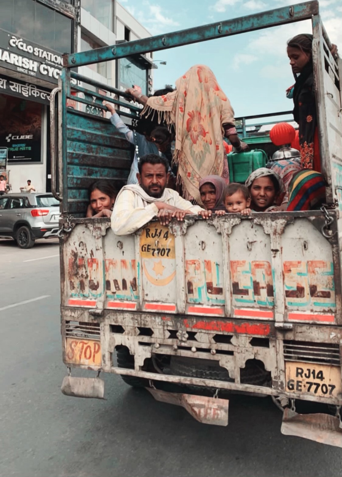 honk ok please, local family hitches a ride in the back of a truck in india