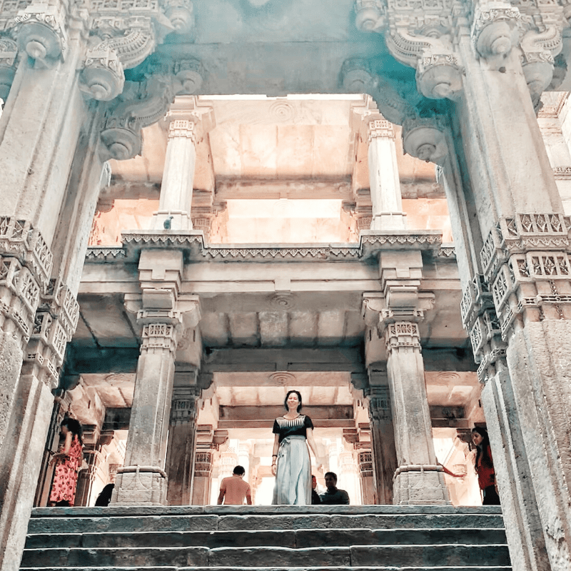 Melanie DiSalvo at stepwell in Ahmedabad in wrap skirt